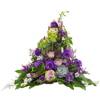 Funeral spray in purple colours.