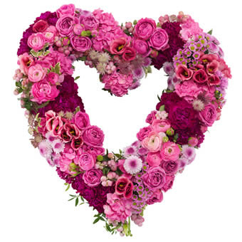 Heart-shaped funeral wreath in pink colours.