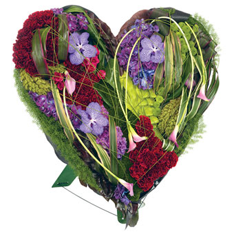 Heart-shaped funeral decoration in mixed colours.